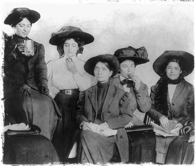 Workers having lunch in typical shirtwaist attire, circa 1910.